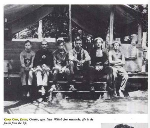 E.B. White (3rd from R) with Otter campers outside their tent cabin.