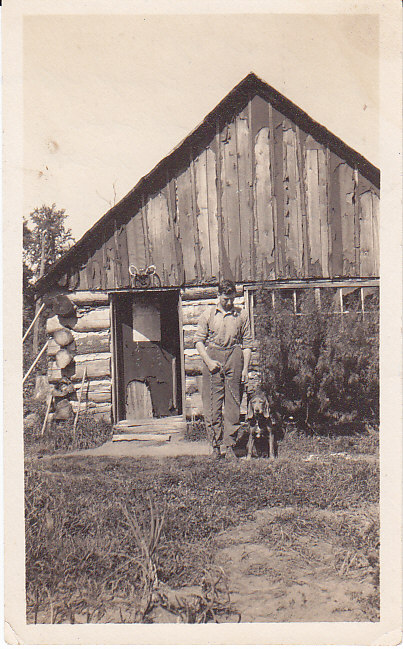 Bill Crewson in front of camp office 1917