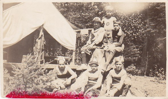 Group of campers with tent