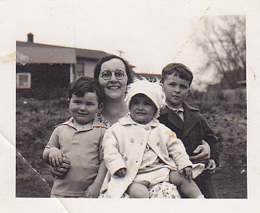 Mrs Showacre, Dick, Jim, Betty.  Her husband was camp doctor in the early years.
