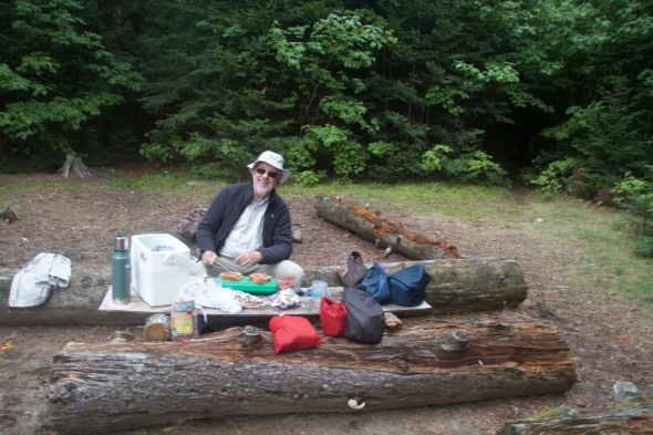 Preparing dinner. The campsite had a nice log and plywood board surface to work from.