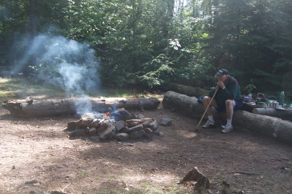Bogie tends the campfire as we use up the last of our wood